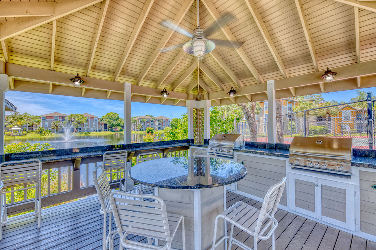 Covered outdoor kitchen with with 2 grills and a beautiful view