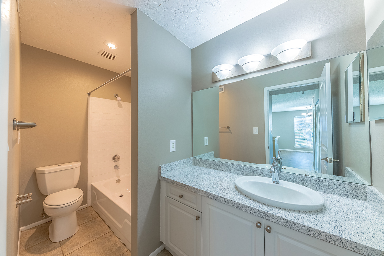 The Ficus (3 Bedroom): Large vanity and mirror in divided bath