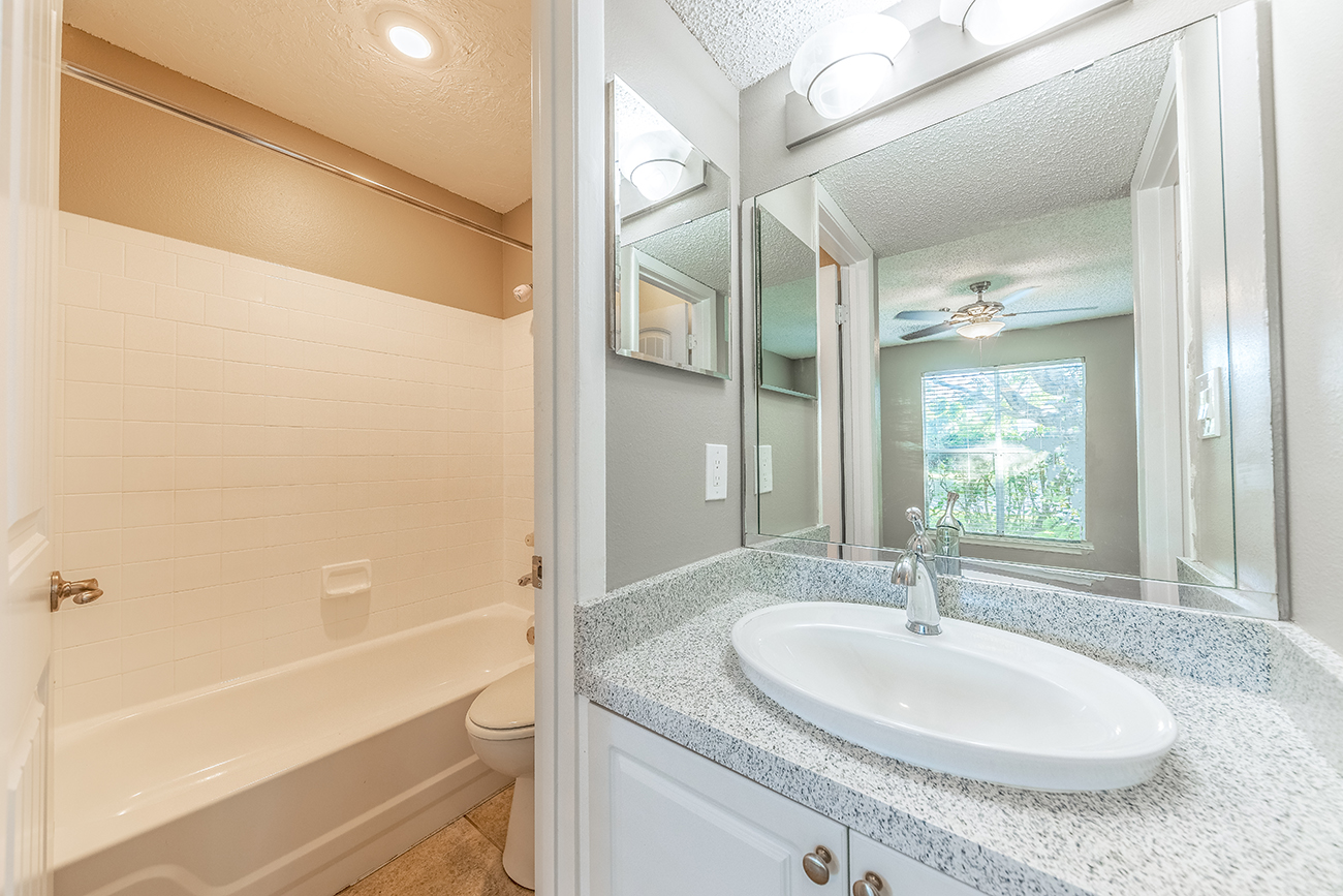 The Ficus (3 Bedroom): Luxury upgrades available (granite vanity tops, raised bowl sink, white panel cabinets, and beautiful fixtures)