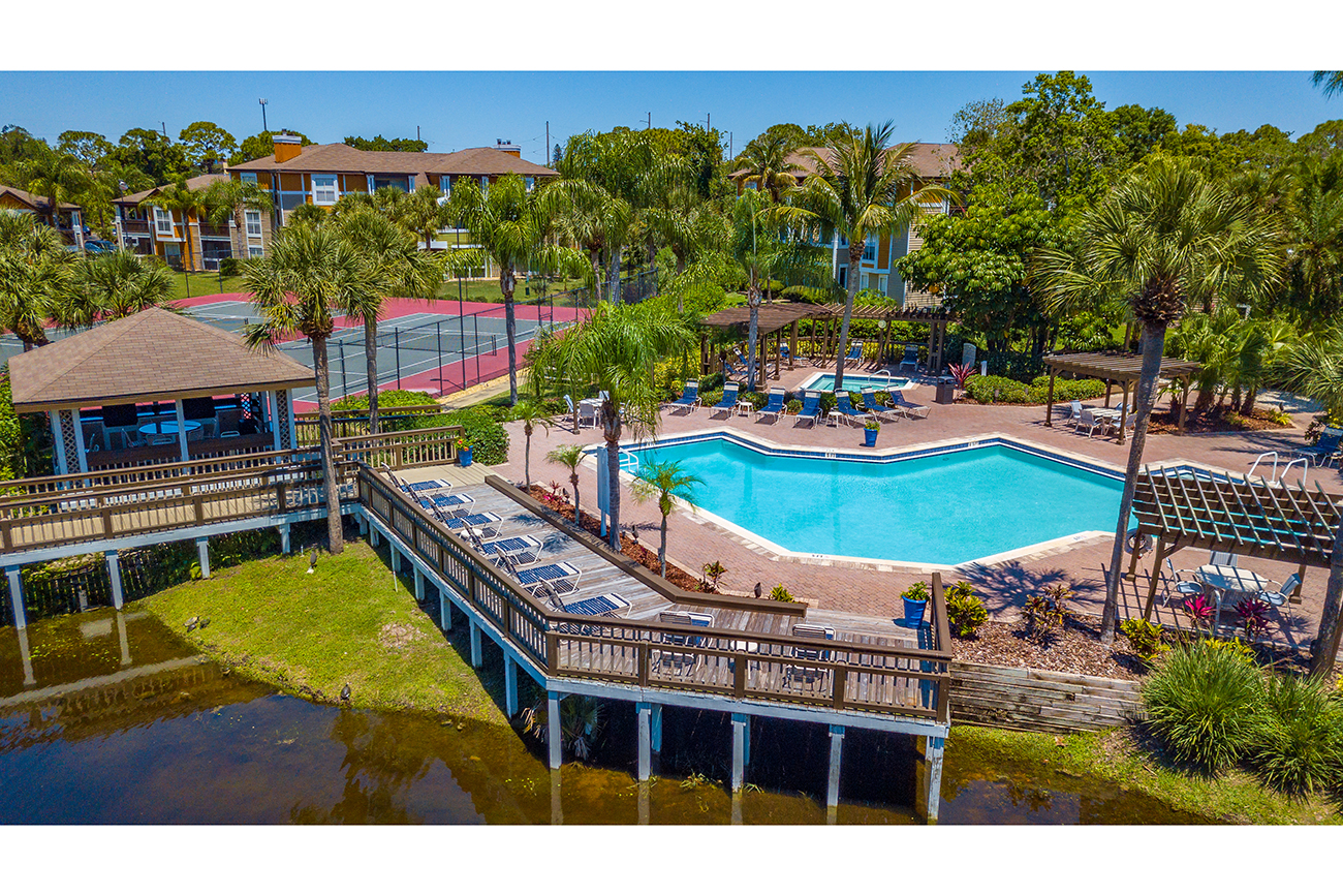Two community pools with plenty of poolside seating