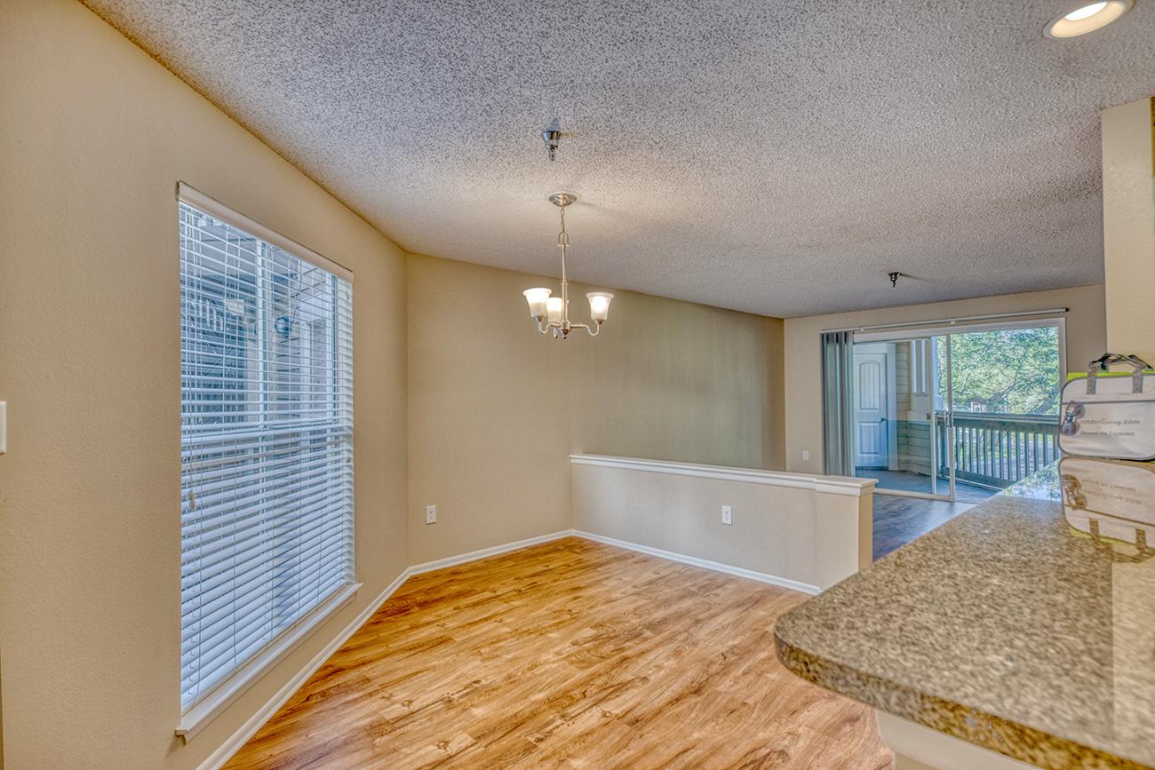 The Elm (2 Bedroom): Wood laminate flooring in select homes