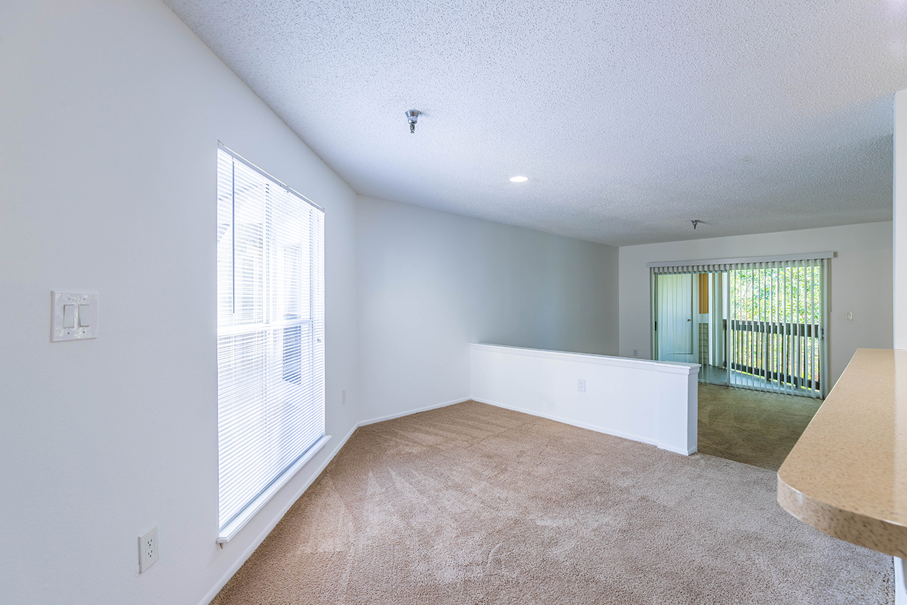 The Elm (2 Bedroom): Unique floor plan with oversized windows and angled walls