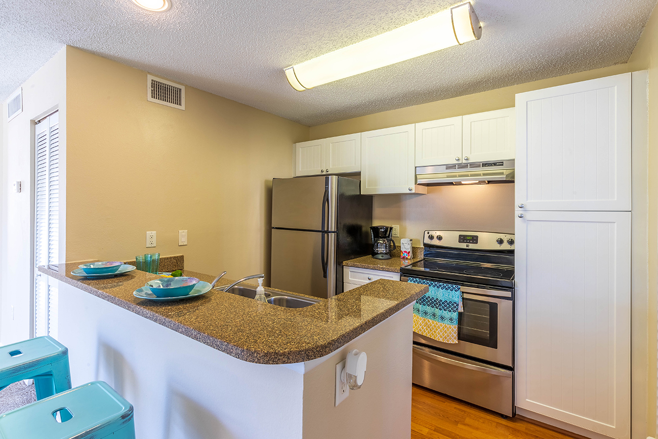The Ashe (1 Bedroom): Beautiful white panel cabinets in select homes